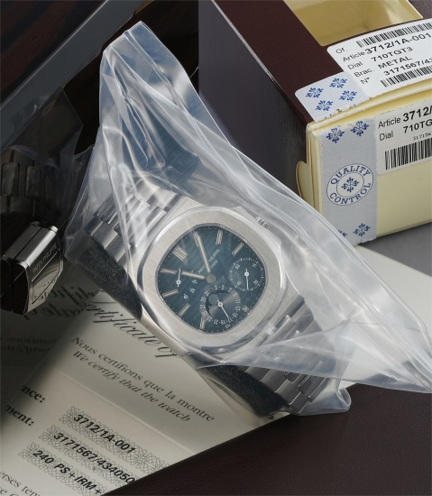 A very fine and rare stainless steel wristwatch with date, moonphases, power reserve and bracelet, with factory service box