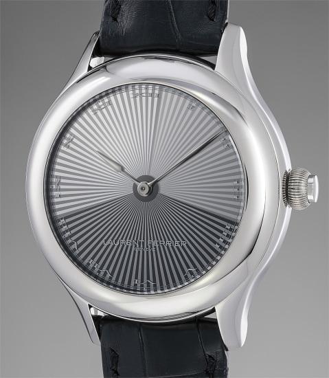 An exceptional and unique white gold tourbillon wristwatch with a hidden diamond set dial