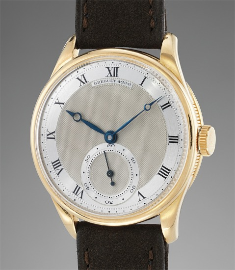 A fine, very rare, and attractive yellow gold wristwatch with two-tone silver guilloché dial