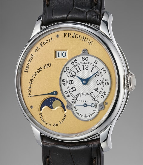 A very find and rare platinum wristwatch with oversized date, power reserve and moonphases