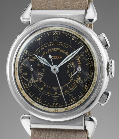 A fine and unusual stainless steel chronograph wristwatch with hooded spider-lugs and black multi-scale dial