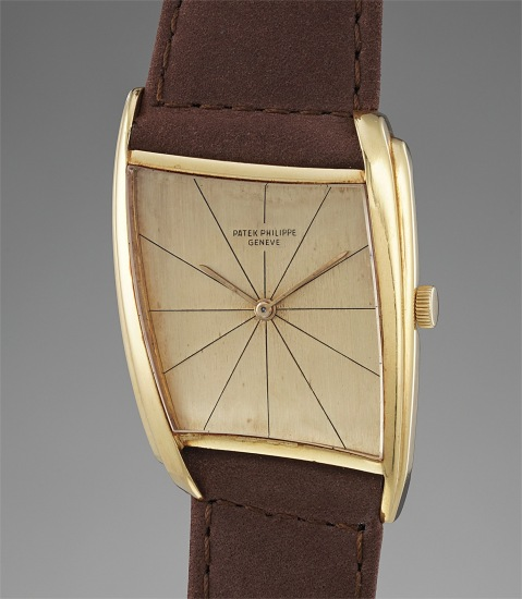 An unusual and attractive asymmetric wristwatch with champagne dial, designed by Gilbert Albert