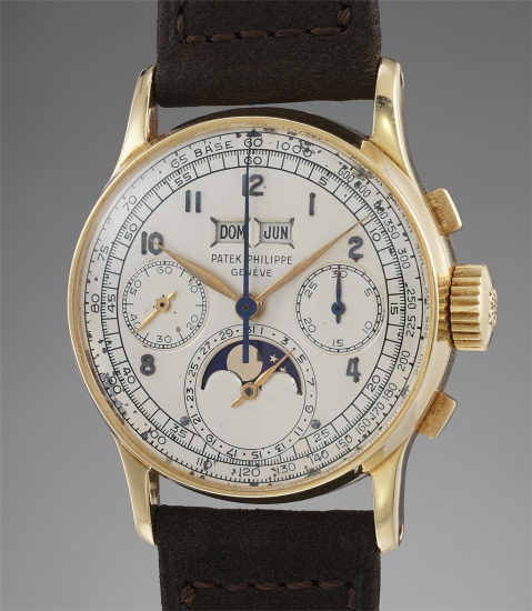 An extremely rare and very well preserved yellow gold perpetual calendar wristwatch with moonphases, original paperwork and box