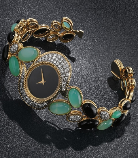 An exquisite, elegant and attractive yellow gold, onyx, diamond and chrysoprase-set bracelet watch, from the collection of Catherine Deneuve