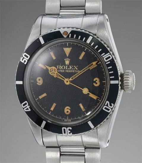 "An extremely rare, important and early stainless steel diver's wristwatch with black glossy ""Explorer"" dial"