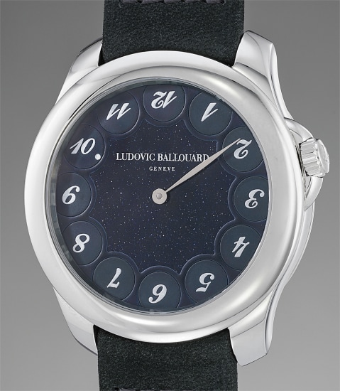 A unique, attractive and unusual jump hour platinum wristwatch with aventurine dial