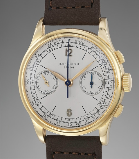 A very rare, large and attractive yellow gold chronograph wristwatch with silver dial and tachymeter retailed by Salvatore Barraja
