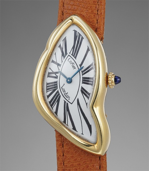 A highly rare and attractive asymmetric yellow gold wristwatch with presentation box