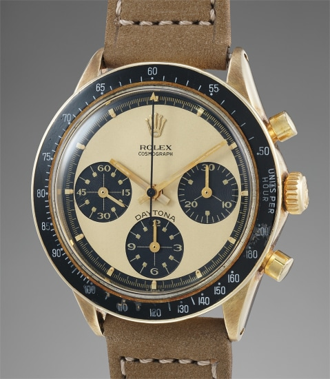 A fine, very rare and highly attractive 14K yellow gold chronograph wristwatch with champagne Paul Newman dial