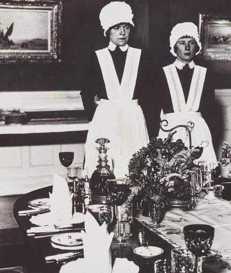 Parlourmaid and under-parlourmaid ready to serve dinner