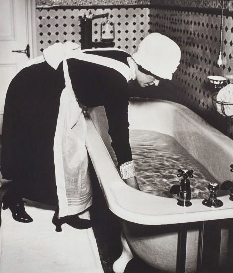 Parlourmaid preparing a bath before dinner, London