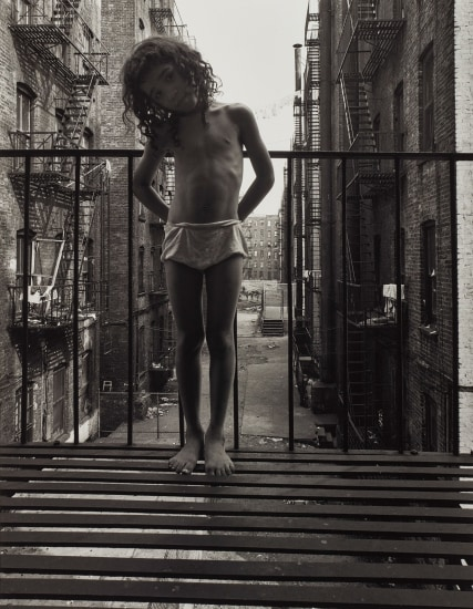 East 100th St, New York (Girl on fire escape)
