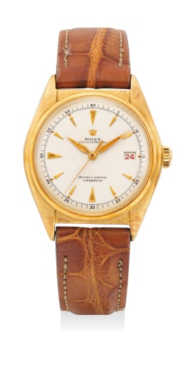 A fine and early yellow gold wristwatch with center seconds and date