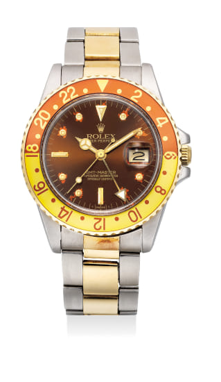 A fine and attractive stainless steel and yellow gold dual-time wristwatch with bracelet