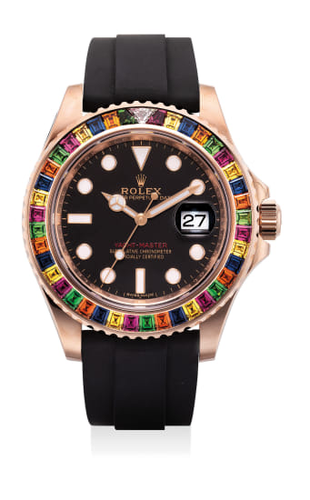 A very fine and unusual pink gold, diamond, tsavorite and sapphire-set wristwatch with center seconds, date, guarantee and presentation box