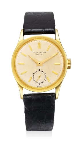 A fine and attractive yellow gold wristwatch with center seconds