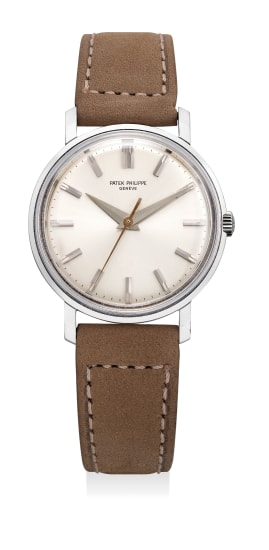 An attractive and very rare white gold wristwatch with center seconds, original Isshin guarantee and presentation box