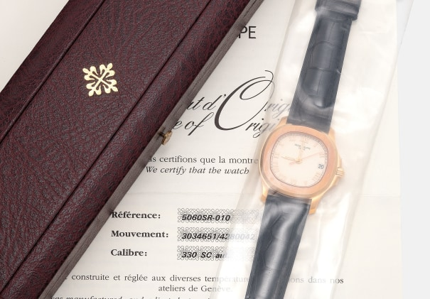A fine and attractive pink gold wristwatch with date, sweep center seconds, certificate of origin and presentation box, single sealed