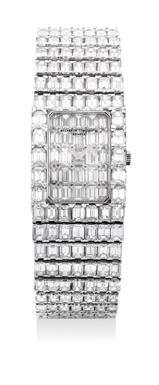 A magnificent, lavish and exceptionally rare white gold with baguette diamond-set bracelet watch with baguette diamond dial