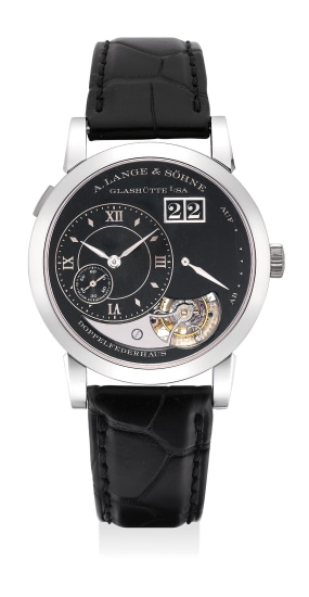 An extremely fine and vary rare limited edition platinum tourbillon wristwatch with black enamel dial, date, hacking mechanism with guarantee and fitted presentation box, numbered 18 of a limited edition of 20 pieces