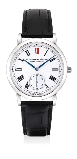 A very rare and extremely fine platinum wristwatch with enamel dial, zero-reset feature, guarantee and box, numbered 196 of a 500 pieces limited edition