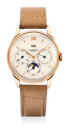 An attractive pink gold triple calendar wristwatch with moonphases