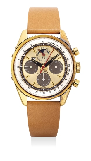 A fine and attractive yellow gold triple calendar chronograph wristwatch with date, day, month, moon phase, two tone dial and tachymeter scale, with guarantee and presentation box