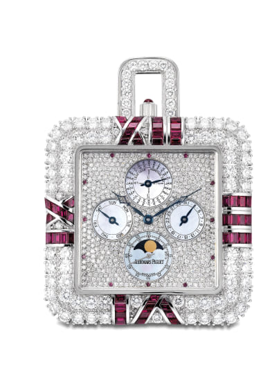 An exceptional and possibly unique white gold, diamond, ruby and mother-of-pearl perpetual calendar watch