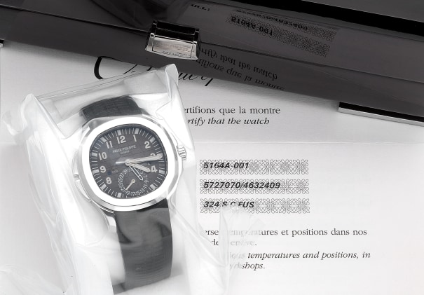 A rare and fine stainless steel dual time wristwatch with sweep center seconds, date, day and night indicator, certificate of origin, setting pin and box, factory sealed