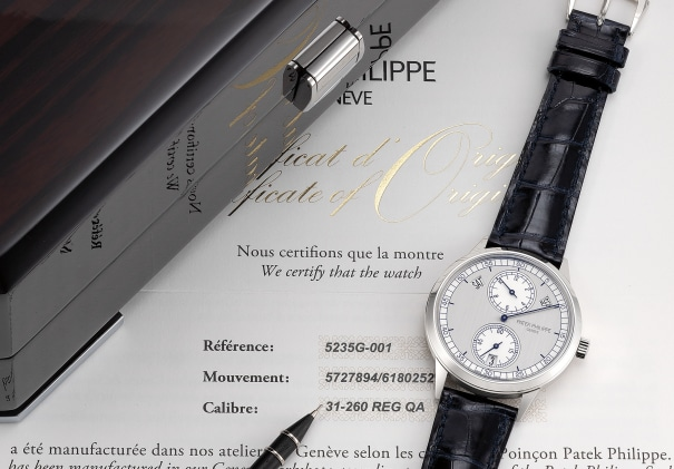 A very fine and rare white gold annual calendar wristwatch with two tone silvered regulator dial, certificate of origin and presentation box