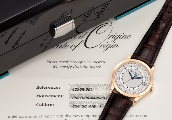 A fine and very attractive pink gold wristwatch with center seconds, date, certificate and box
