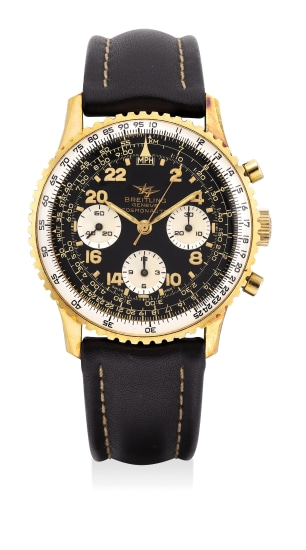 A fine yellow gold-plated stainless steel chronograph wristwatch with black gilt dial, tachymeter scale and slide rule bezel