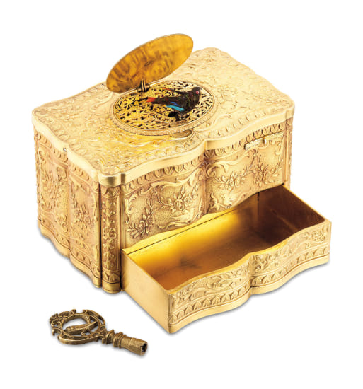 A very rare and highly attractive gilt metal singing bird box with automated drawer and winding key
