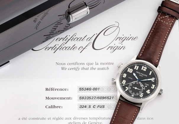 A very fine and attractive 18k white gold dual-time wristwatch with date, certificate of origin and presentation box