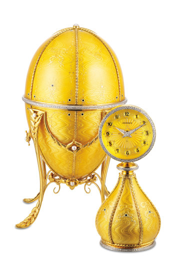 A very fine and rare yellow gold, enamel, diamond and pearl-set egg-shaped clock with yellow gold stand and presentation box