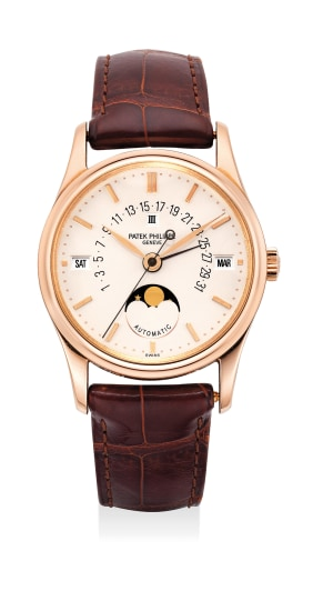 A very fine and attractive pink gold perpetual calendar wristwatch with center seconds, retrograde calendar, moon phase and leap year indication with certificate of origin, additional solid case back and setting pin
