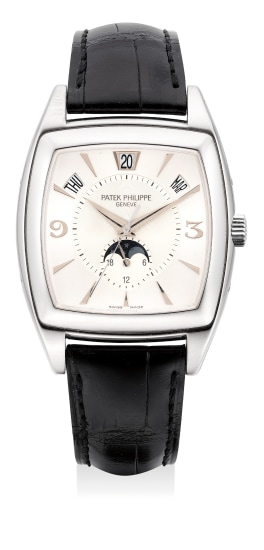A fine and rare white gold annual calendar wristwatch with center seconds, moon phases, certificate and box