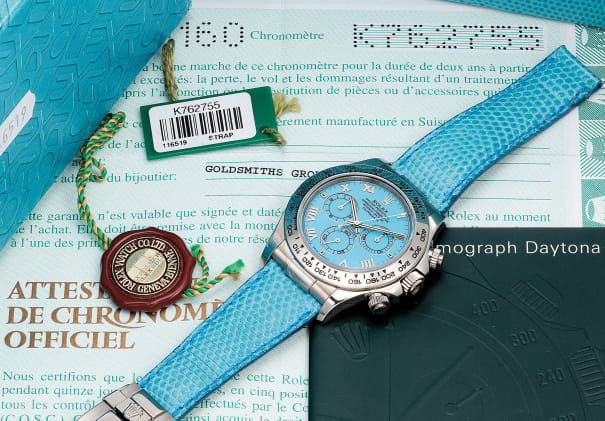 A fine and unusual white gold chronograph wristwatch with turquoise dial, guarantee and box