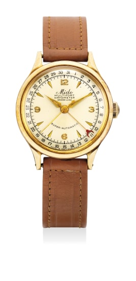 A fine yellow gold wristwatch with center seconds and date