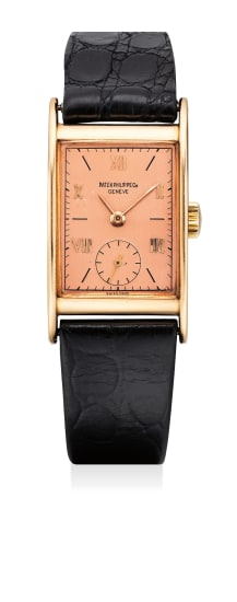 A fine and attractive pink gold rectangular wristwatch with rose-colored dial