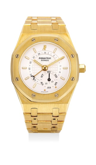 A rare and fine yellow gold annual calendar wristwatch with bracelet, guarantee and box