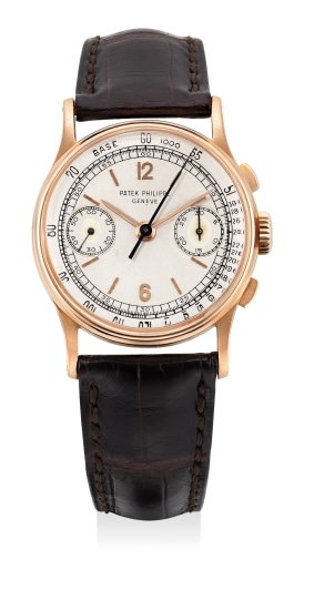 A fine and attractive pink gold chronograph wristwatch with tachymeter scale and presentation box