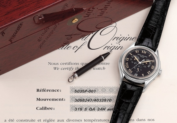 A fine and attractive platinum annual calendar wristwatch with center seconds, 24-hours, certificate and box