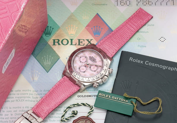 A fine, unusual and very attractive white gold automatic chronograph wristwatch with pink mother-of-pearl dial, guarantee and box