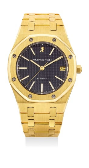 A fine yellow gold wristwatch with center seconds, date, bracelet, certificate and box