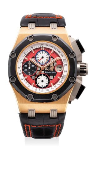 An attractive pink gold and ceramic chronograph wristwatch with date, presentation box and certificate