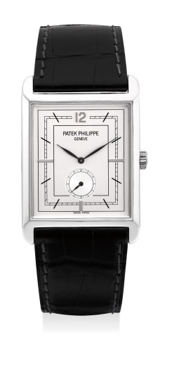 A fine and attractive platinum rectangular wristwatch with silvered dial, certificate and presentation box