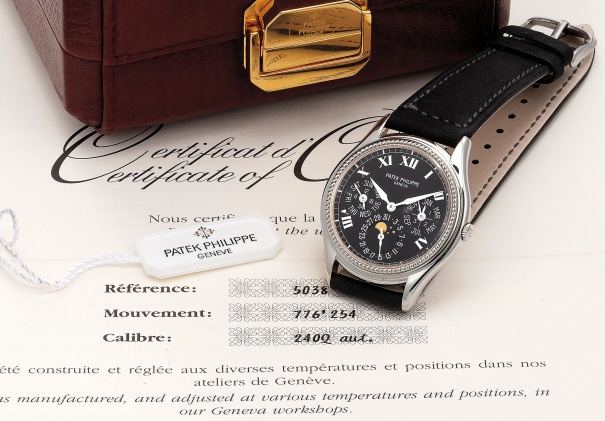 A fine and attractive limited edition white gold perpetual calendar wristwatch with hobnail bezel, moon phases, Roman numerals with certificate and box