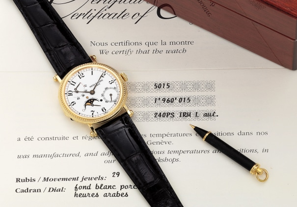 A fine and attractive yellow gold wristwatch with small seconds, moon phases, 48-Hour power reserve, hobnail bezel, officier caseback, certificate, extract from the archives and presentation box