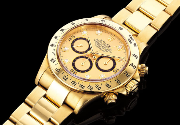 A fine and attractive yellow gold chronograph wristwatch with bracelet, champagne and diamond-set dial and presentation box